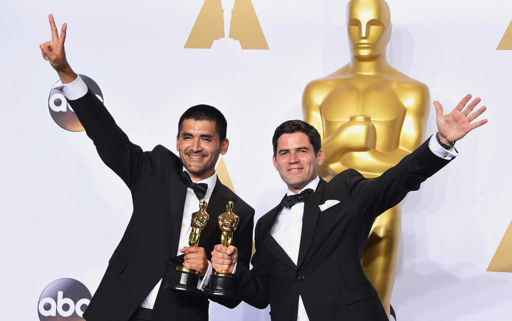 HOLLYWOOD, CA - FEBRUARY 28: Director Gabriel Osorio Vargas (L) and producer Pato Escala Pierart, winners of Best Animated Short Film for 'Bear Story,' pose in the press room during the 88th Annual Academy Awards at Loews Hollywood Hotel on February 28, 2016 in Hollywood, California.   Jason Merritt/Getty Images/AFP == FOR NEWSPAPERS, INTERNET, TELCOS & TELEVISION USE ONLY ==